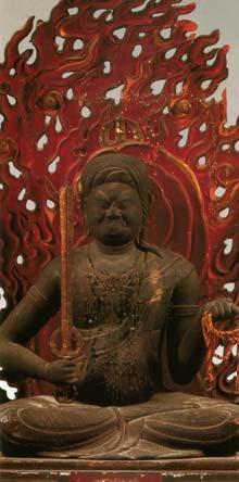 """[Рис.1. Фудо – буддийское божество, уничтожающее злых духов и прочие препятствия, мешающие буддистам в их духовном пути. Считается, что он погружается в огненную медитацию (Kasho Zammai), в которой он источает огонь и уничтожает все кармические препятствия. Он никогда не колеблется перед препятствиями и поэтому прозван """"Fudo"""" – «Непоколебимый». Это божество символизирует непоколебимый разум и тело, которое не дрогнет даже будучи окруженным опасностью. Это божество было популярно у японских воинов (буси или самураев), которые видели себя хранителями порядка в стране, окруженной хаосом.]"""